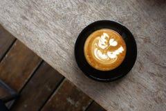 Una tazza del caffè di arte del latte Fotografie Stock Libere da Diritti