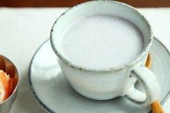 Una tazza della bevanda Immagine Stock