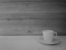 Una tazza di caffè con la parete Fotografie Stock Libere da Diritti