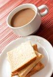 Una tazza di caffè e un pane Fotografia Stock Libera da Diritti