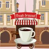 Una tazza di caffè ha stilizzato il caffè della via sopra spinge dentro la città Immagine Stock