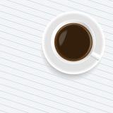 Una tazza di caffè sul foglio di carta Immagine Stock Libera da Diritti