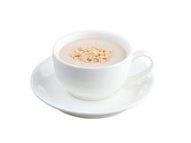 Una tazza di latte con cereale Fotografie Stock