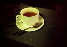 Una tazza di tè nero Fotografia Stock