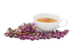 Una tazza di tè rosa su fondo bianco Fotografie Stock