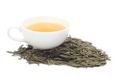 Una tazza di tè verde su fondo bianco Fotografia Stock