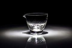 Una tazza di vetro fotografie stock