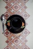 Una tazza e un cucchiaio Fotografie Stock