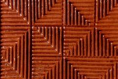Una textura notable de la teja del duplicado del rojo sobre una base de cerámica Fotografía de archivo