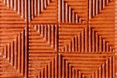 Una textura notable de la teja del duplicado del rojo sobre una base de cerámica Fotos de archivo libres de regalías