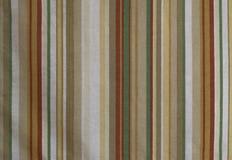 Una textura real de la tela con las rayas del color Colores suaves foto de archivo
