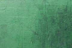Una textura verde apenada de la pared Imágenes de archivo libres de regalías
