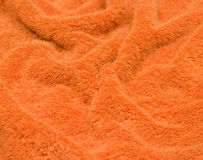 Una toalla anaranjada, estropeada, factura Imagenes de archivo
