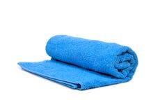Una toalla azul rodada para arriba Imágenes de archivo libres de regalías