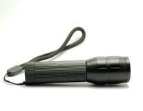Una torcia elettrica è una luce elettrica tenuta in mano portatile Fotografia Stock Libera da Diritti