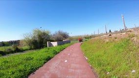 Una trayectoria de la bici al lado de la Rotonda hace Relogio en Lisboa metrajes