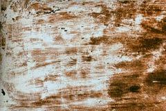 Una vecchia parete arrugginita con le macchie Giallo e rosso Fotografie Stock Libere da Diritti