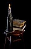 Una vela en una botella imagen de archivo