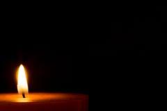 Una vela para la Navidad Imagen de archivo libre de regalías