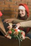 Una vela y un piano de la Navidad Imagen de archivo
