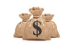 Una vista di tre sacchetti dei soldi con il segno del dollaro US Fotografia Stock