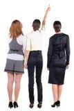 Una vista posteriore di bello giovane sguardo di bussineswoman tre fotografia stock