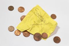 Unable to save money. pennies yellow wrinkled note stock photo