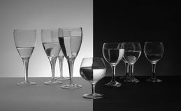 Unacceptable. A glass that is different in height and shape is unacceptable in two groups of glasses royalty free stock images