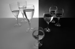 Unacceptable. A glass that is different in height and shape is unacceptable in two groups of glasses stock images