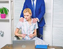 Unacceptable behavior at workplace. Banned relations at work. Sexual harassment at workplace. Woman office manager royalty free stock photography