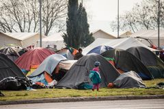 Refugee crisis in Europe. Unaccompained minor in his refugee camp march 2016, Idomeni, Greece Royalty Free Stock Photo