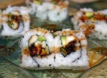 Unagi Eel Sushi On A Decorative Plate. Eel (unagi) sushi served on a decorative glass plate royalty free stock photo