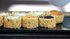 Unagi maki rolls with sauce. Tasty sushi close up stock video footage