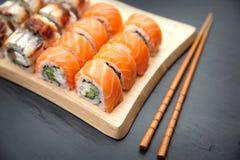 Unagi and Philadelphia roll Traditional Japanese Food. Roll Philadelphia made of Fresh Salmon, Cream Cheese and Avocado inside. Unagi roll with Smoked Eel Stock Photos