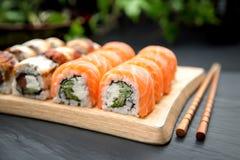Unagi and Philadelphia roll Traditional Japanese Food. Roll Philadelphia made of Fresh Salmon, Cream Cheese and Avocado inside. Unagi roll with Smoked Eel Stock Photo