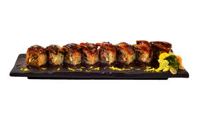 Unagi roll. Japanese eel sushi roll set on wooden ceramic plate.Traditional dinning of Japanese cui Stock Photography