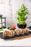 Unagi roll with smoked eel, avocado, cream with Philadelphia cheese and salmon inside. Sushi menu. stock photo