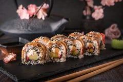 Unagi roll with smoked eel, avocado, cream with Philadelphia cheese, tobiko caviar. Sushi menu. stock photos