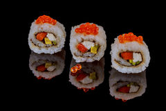 Unagi rolls spicy roru with eel on a black background Stock Images