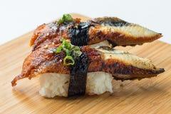 Unagi Sushi Nigiri. Topping Tobiko, Scallion and Eel Sauce stock images