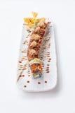 Unagi suszi: Japończyka Wraped Ryżowy Avocado i ser polewa z Piec na grillu Unagi Japońskim Słodkowodnym węgorzem, Katsuobushi i Zdjęcie Stock