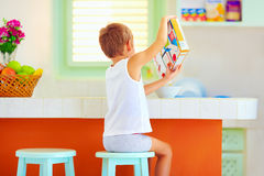 Unaided little boy preparing breakfast in the morning at home Stock Photography