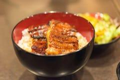 Unaju, weißer Reis überstieg mit gegrilltem Aal Stockfotos