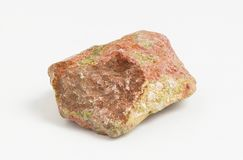 Ore Unakite on white background, First discovered in the United States in the Unakas mountains of North Carolina from which it get. Unakite is an altered granite royalty free stock photography