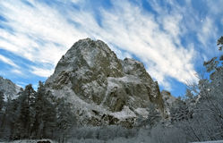 Unapproachable snow-covered rock. Royalty Free Stock Photo