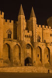Unassailable. Middle-aged pope's palace in Avignon at night Stock Photos