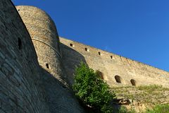 Unassailable fortress. Tower and  fortress wall view from the bottom up Ivangorod  Russia Stock Image
