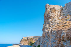 The unassailable fortress. The view on rocky slopes with Venenian citadel on the top, Rethymno, Greece Royalty Free Stock Image