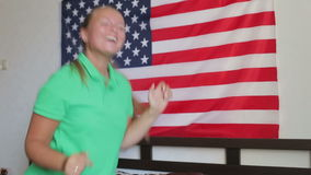 Unated states flag. Beautiful girl having fun. Flag of United States of America hanging on a wall, independence Day stock video footage