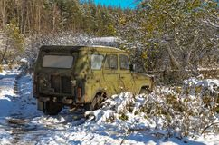 Car abandoned in the woods Royalty Free Stock Image